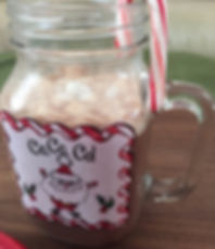 Kidfunideas.com warm and creamy hot coco example picture -  coco in a mug with a peppermint stick.