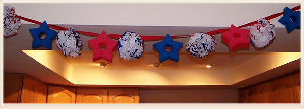 Kidfunideas.com 4th of July Garland.  Super easy 4th of July craft for kids using Pool noodles and ball puffs