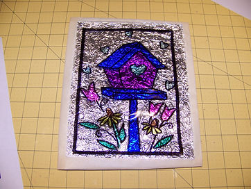 Kidfunideas.com Valentine's Stained glass picture of attaching the pattern to the paper