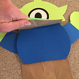 Kidfunideas.com Alien paper bag puppet attaching the chest piece to the puppet picture