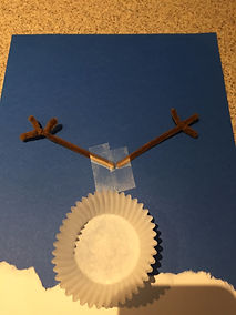 Kidfunideas.com cup cake paper snowman craft example picture - attaching the arms