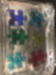 Kidfunideas.com Autism awareness bracelet craft picture of the colored puzzle pieces on the foil