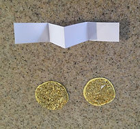 Kidfunideas.com St. Patrick's day leprechaun trap picture of making the gold bate coin