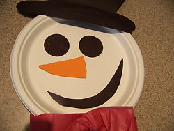 Kidfunideas.com paper plate snowman craft picture of making the face