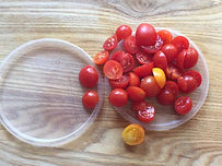 Kidfunideas tip: cut a bunch of cherry tomatoes at once using two plastic lids