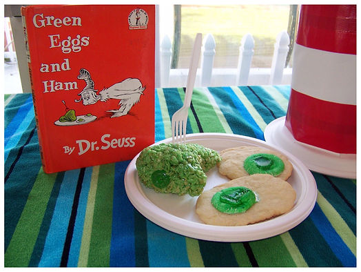 Kidfunideas.com Green Eggs and Ham Treats !  Picture of green egg cookies and green ham  crispy rice treats