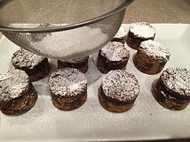 Kidfunideas.com Santa chimney treat example picture - adding powdered sugar to the cookies