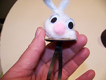 Kidfunideas.com rabbit out of the hat magic trick picture of the rabbit attached to the string and cover piece