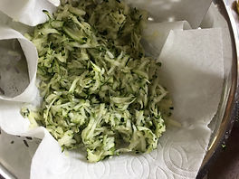 Kidfunideas.com zucchini cheddar hash browns - picture of shredded and drained zucchini