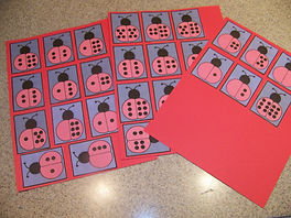 Kidfunideas.com Ladybug dominoes game. Picture of making the dominoes