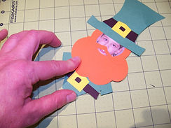 Kidfunideas.com Little Leprechaun me craft picture of putting the hat on the Leprechaun