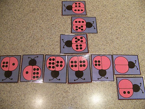 Kidfrunideas.com ladybug dominoes picture of the dominoes laid out