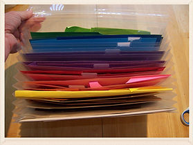 Kidfunideas.com crafting tip: store paper scraps in an accordion folder by color for quick reuse.