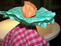 Kidfunideas.com color changing flower magic trick picture of revealing the orange flower