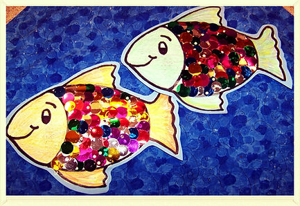 Kidfunideas.com Rainbow fish craft for kids.  A quick and easy summer craft - make this pretty Rainbow fish craft.  Great for any Ocean unit or underwater theme