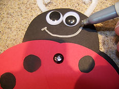 Kidfunideas.com my little ladybugs craft- picture of drawing in the face