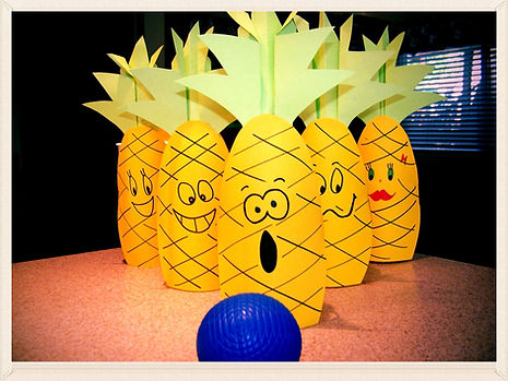 Kidfunideas.com Pineapple bowling game for kids.  What a fun summer game and craft for kids.  Knock down all these silly pineapples with this easy to make bowling game for kids.