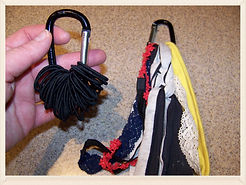 Kidfunideas.com tip: corral hair ties using a clip