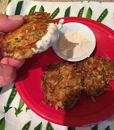 Kidfunideas.com zucchini cheddar hash brown cakes picture of a hash brown dipped in cilantro lime dressing
