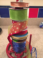 Kidfunideas.com tip hero tip: Put ribbons on a paper towel holder when wrapping gifts.  They stay put and are easy to use.