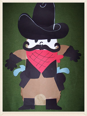 Kidfunideas.com Western Rustler paper bag puppet.  A fun and easy craft for kids to make.  Perfect for any cowboy themed party or classroom unit