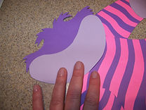 Kidfunideas.com Cheshire cat craft picture of attaching the face pieces