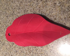 Kidfunideas.com poinsettia craft project picture directions- how to shape the petals picture