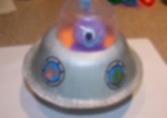 Kidfunideas.com paper bowl flying saucer and alien craft picture of applying the decals to the spaceship