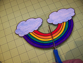 Kidfunideas.com 3D rainbow craft picture of making the slits to assemble