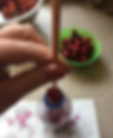 Kidfunideas.com tip hero tip: remove the pit from a cherry easily using a chopstick and an empty water bottle
