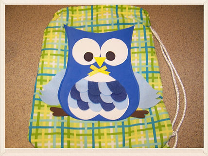 Kidfunideas.com Owl drawstring backpack craft for kids.  How fun is this easy sewing projects for kids.  A great beginner sewing craft for kids.  Take this pack to the pool or the library or for a fun picnic