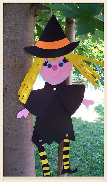 Kidfunideas.com Halloween Witch craft project.  This cute witch is a fun Halloween kid's craft.  The arms and legs move and it's a great addition to your Halloween decor.