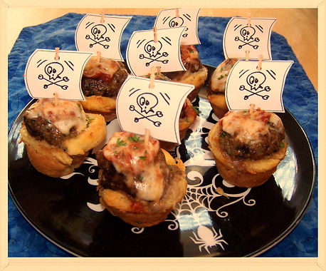 Kidfunideas.com Pirate Ship Cannonball bites.  A yummy Pirate themed meatball boat. Perfect for Talk Like a Pirate day, a Pirate party or Halloween