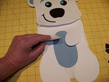 Kidfunideas.com polar bear paper bag puppet picture of assembing the body