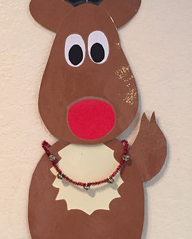 Kidfunideas.com Rudolph the red nose reindeer example picture - how to make his jingle bell necklace