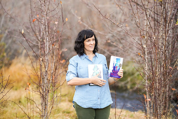 Author holding two books.
