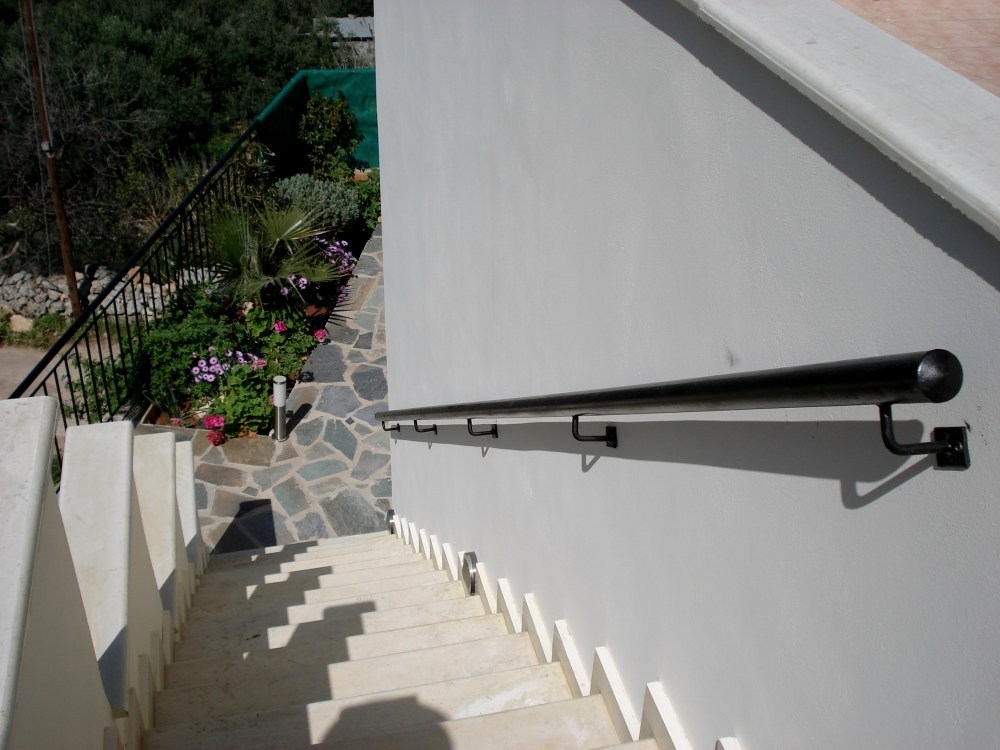Steps from roof terrace