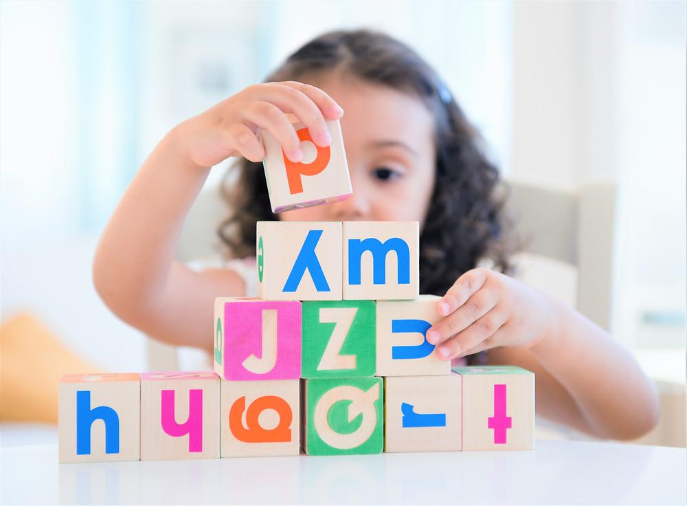 Kid stacking blocks