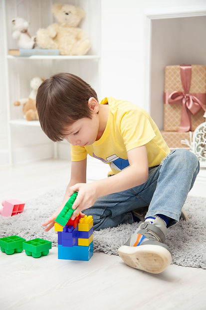 Boy playing with blocks.jpeg