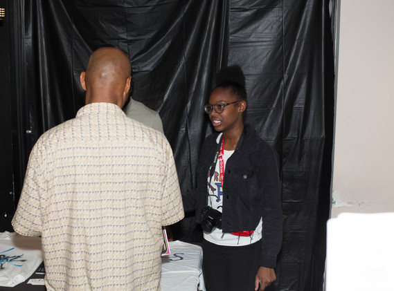 CEO of Kreative Fits Explaining Her Business to a Guest