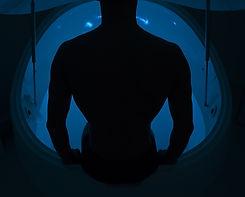 man in a float tank blue light.jpg