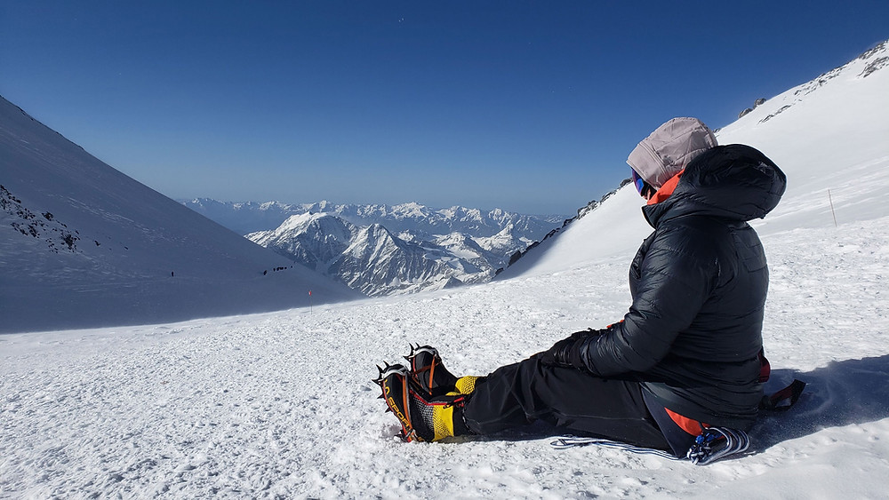 Janelle Routhier resting during her climb of Mt. Elbrus