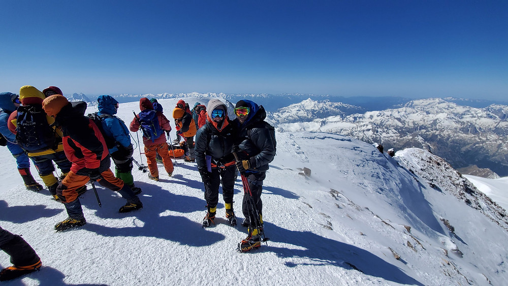 Climbers at the summit of Mt. Elbrus including Jaye and Frank Routhier