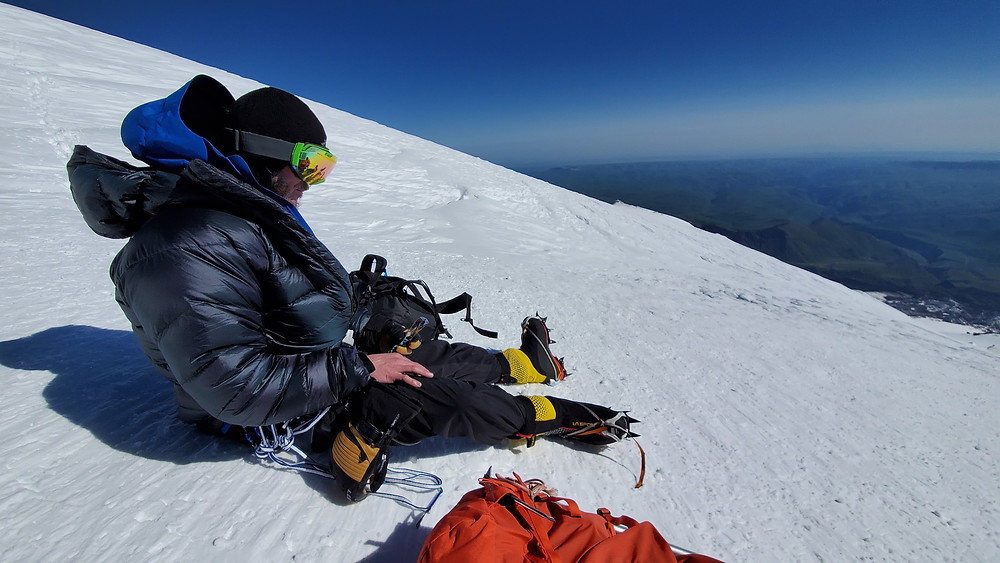 Frank Routhier having a snack on the side of Mt. Elbrus