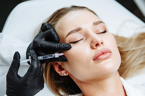 Young woman receiving plastic surgery in