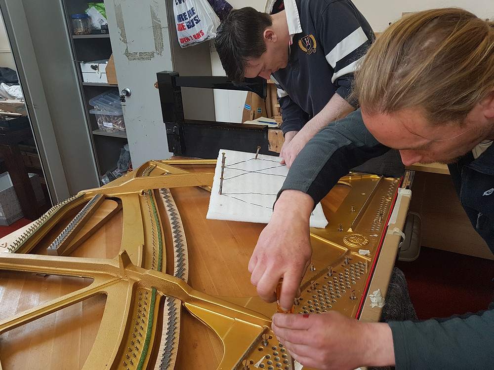 Wasting no time after the Easter break, Chris and Lawrence get on re-stringing a Grand Piano yesterday.