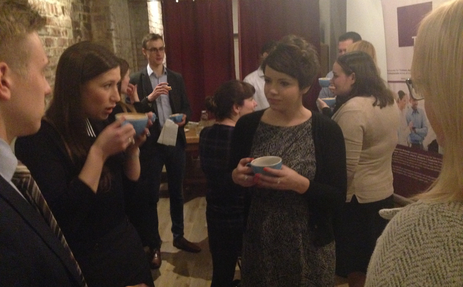 Professionals networking over coffee