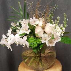 white arrangement with orchids.jpg