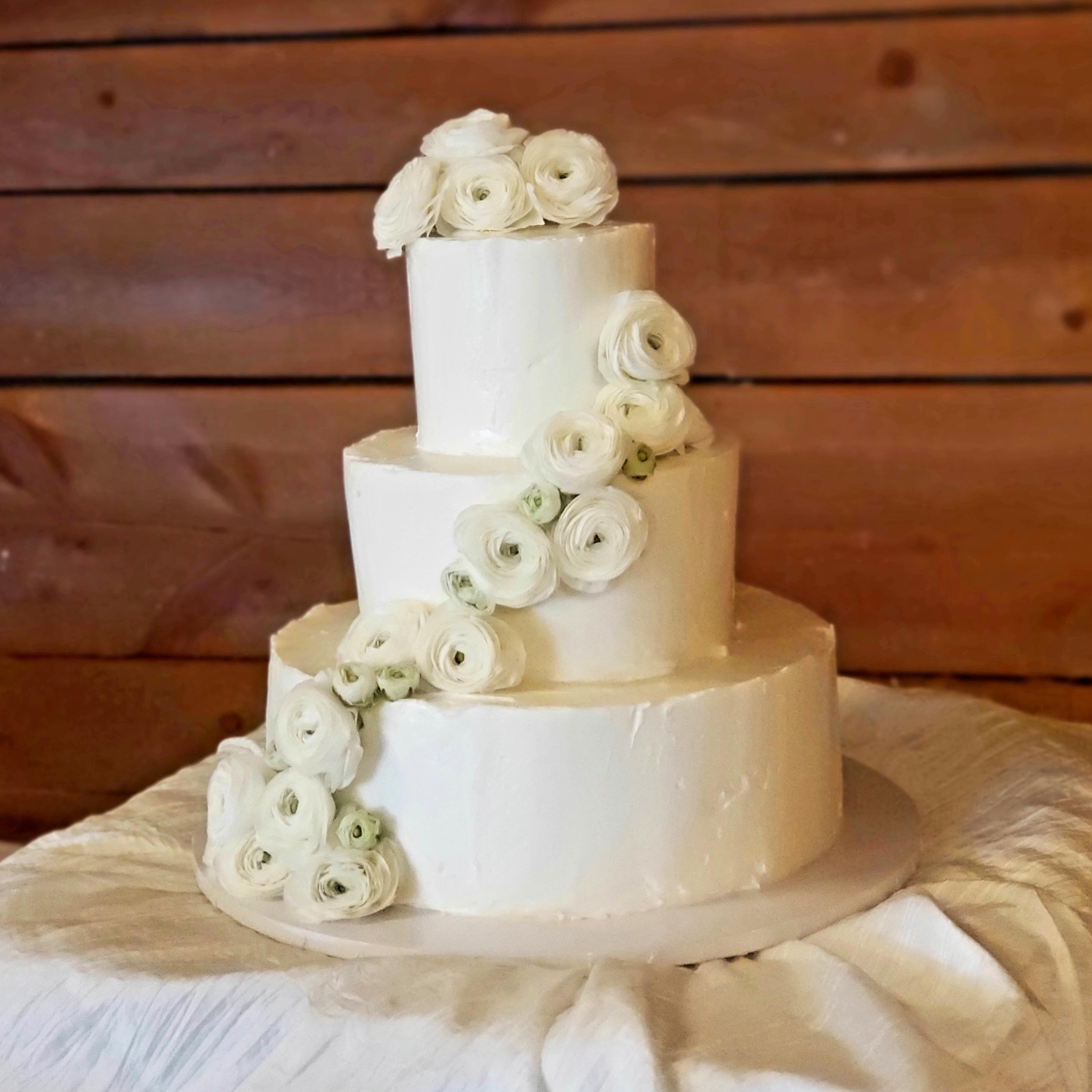 ranunculus swag cake flowers