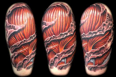 3d skin rip muscle tattoo